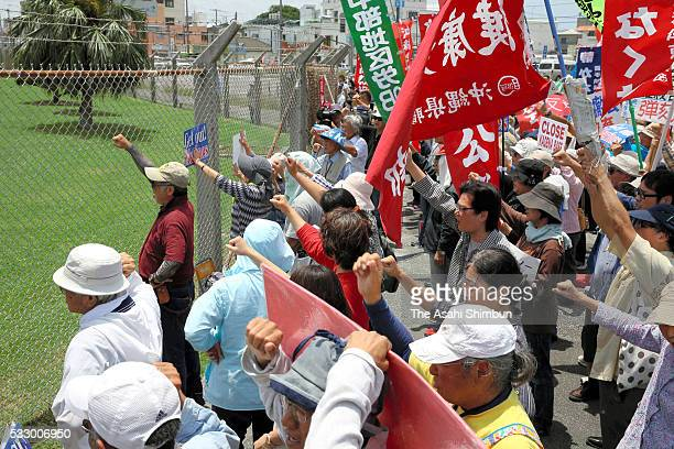 Protesters demand the withdrawal of US bases from Okinawa during a rally in front of the US Kadena Air Base a day after an US military base worker...