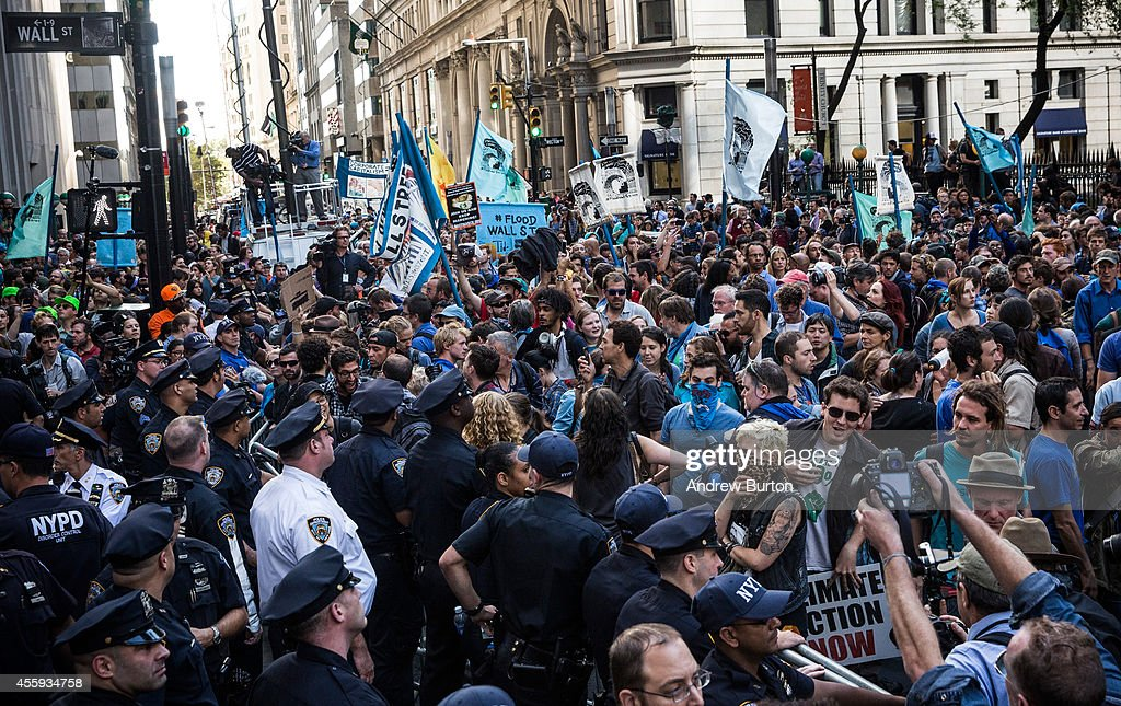 Protesters demanding economic and political changes to curb the effects of global warming clash with police as try to walk down Wall Street towards the New York Stock Exchange on September 22, 2014 in New York City. Approximately 2,600 protesters participated; despite blocking traffic on numerous streets, few arrests were made.