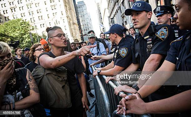 Protesters demanding economic and political changes to curb the effects of global warming clash with police as try to walk down Wall Street towards...