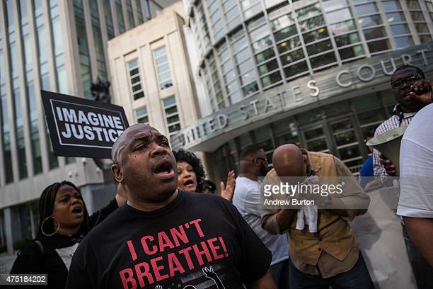Protesters demanding further action against the police officers responsible in the death of Eric Garner gather outside the federal court house on May...