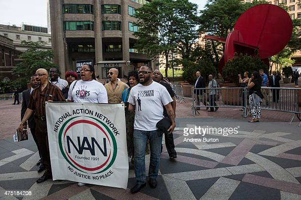 Protesters demanding further action against the police officers responsible in the death of Eric Garner march outside New York Police Department...
