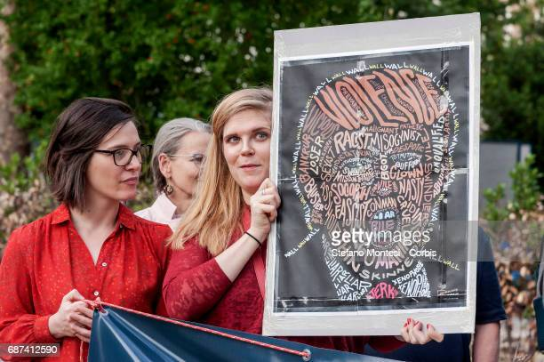 Protesters demonstate against the visit of U.S. President Donald Trump and the policies of the U.S. Administration on May 23, 2017 in Rome, Italy....
