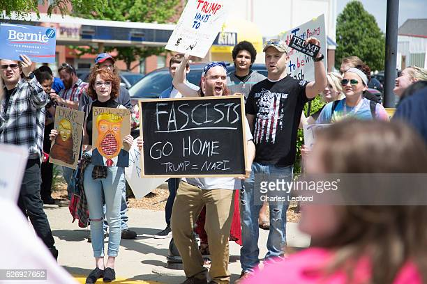 Protesters demonstrate after a rally by Republican presidential candidate Donald Trump at the Indiana Theater on May 1 2016 in Terre Haute Indiana...