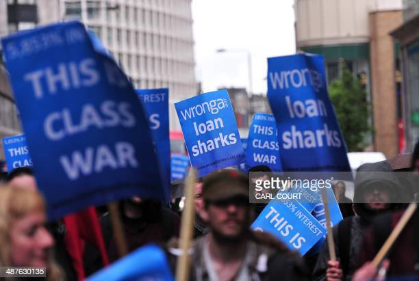 Protesters demonstrate against British payday loan company 'Wonga' in central London, on May 1, 2014. AFP PHOTO/CARL COURT