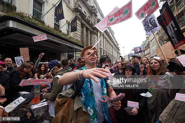 TOPSHOT Protesters demonstrate against British Prime Minister David Cameron outside the Conservative Partys Spring Forum in central London following...