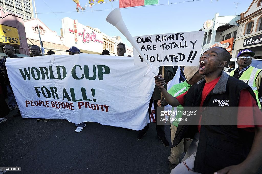 Protesters demonstrate against the 2010 World Cup in central Durban, South Africa, on 16 June, 2010 protesting lavish spending on the World Cup and the sacking of security staff, inflicting fresh embarrassment on organisers. As the country marked the 34th anniversary of the Soweto uprising against apartheid rule, around 3,000 people marched in Durban to denounce FIFA and the government for their spending priorities when millions live in poverty.AFP PHOTO / Aris Messinis