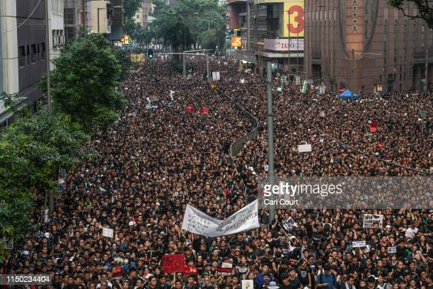Protesters demonstrate against the nowsuspended extradition bill on June 16 2019 in Hong Kong Large numbers of protesters rallied on Sunday despite...