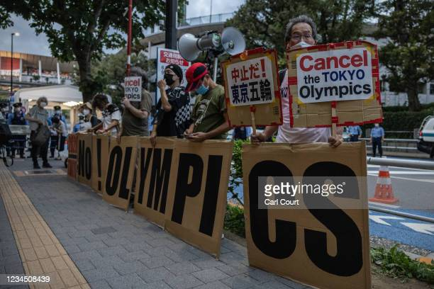 Protesters demonstrate against the Olympics near the main Olympic Stadium on August 6, 2021 in Tokyo, Japan. Fans have been barred from most Olympic...