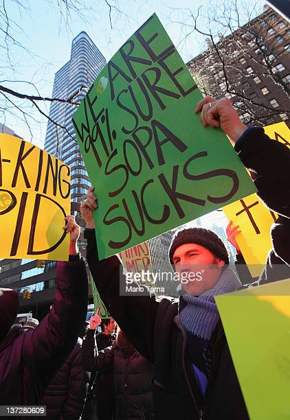 Protesters demonstrate against the proposed Stop Online Piracy Act and Protect IP Act outside the offices of US Sen Charles Schumer and US Sen...