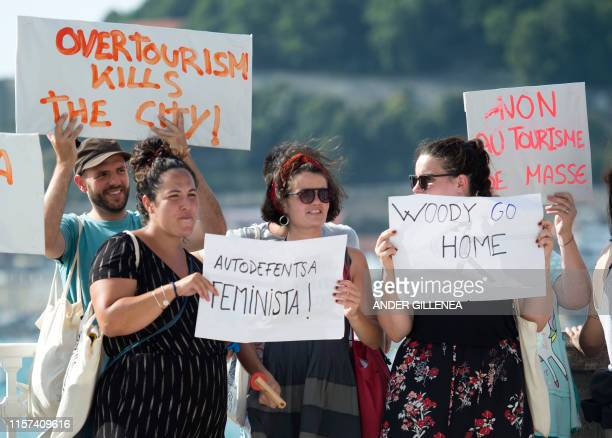 Protesters demonstrate against the shooting of Woody Allen's new film in the Spanish Basque city of San Sebastian on July 23 2019 The demonstrators...