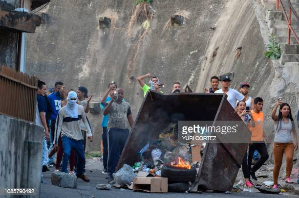 Protesters demonstrate against Venezuela's president Nicolas Maduro in front of the Cotiza Bolivarian National Guard headquarter in Caracas Venezuela...