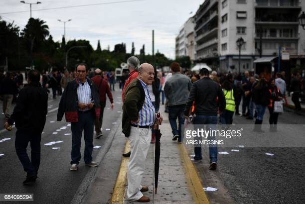 Protesters demonstrate during a 24hour general strike against a new round of austerity cuts imposed by the country's international creditors in...