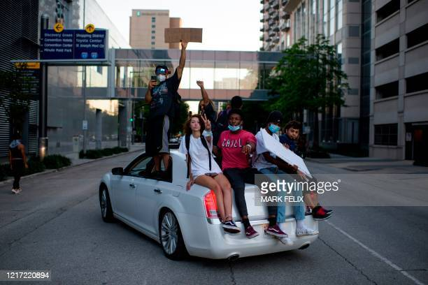 TOPSHOT Protesters demonstrate during a peaceful march to mourn the death of George Floyd in downtown Houston Texas on Tuesday June 2 2020 Antiracism...