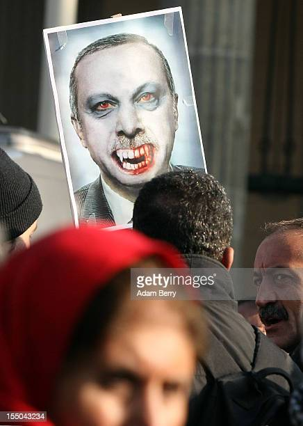 Protesters demonstrate in front of the Brandenburg Gate against the state visit of Turkish Prime Minister Recep Tayyip Erdogan with German Chancellor...