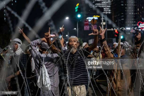 Protesters demonstrate in front of the Elections Supervisory Agency after the official government election results were announced on May 21 2019 in...