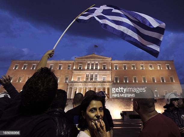 Protesters demonstrate in front of the Greek parliament in Athens against a new austerity package on May 26 2011 Thousands of people assembled for...