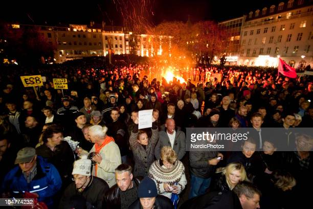 Protesters demonstrate in front of the Icelandic Parliament house as thousands of people are protesting the governments inability to handle the...