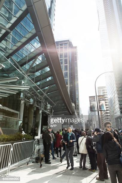 Protesters demonstrate in front of the Trump International Hotel and Tower in Vancouver during the hotel's opening day on February 28 2017 / AFP /...