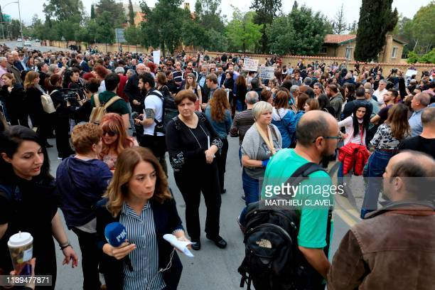 Protesters demonstrate in support of the victims of a suspected serial killer in front of the presidential palace in Nicosia on April 26 2019 Cypriot...