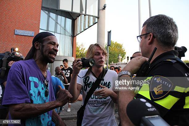 Protesters demonstrate in The Hague's Schilderswijk district the Netherlands on July 01 after Mitch Henriquez from Aruba died in police custody on...