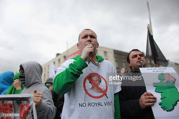 Protesters demonstrate in the streets adjacent to the Garden on Remembrance where Queen Elizabeth II laid a wreath on May 17 2011 in Dublin Ireland...
