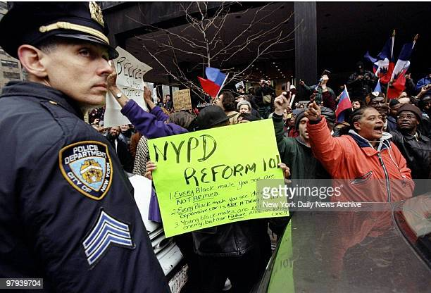 Protesters demonstrate near the United Nations at 47th St between First and Second Aves against the acquittal of four white police officers in the...