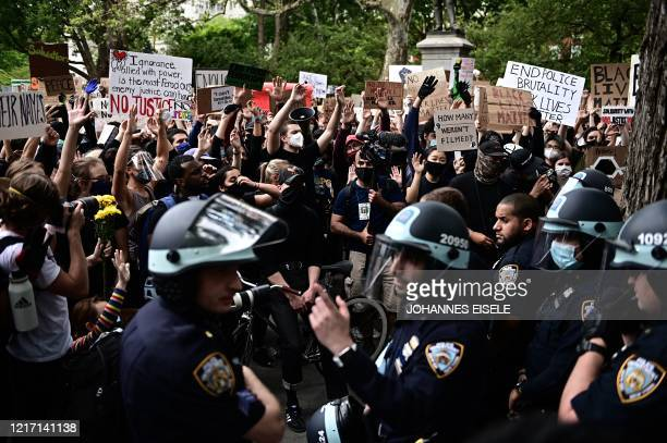 Protesters demonstrate on June 2 during a Black Lives Matter protest in New York City Antiracism protests have put several US cities under curfew to...