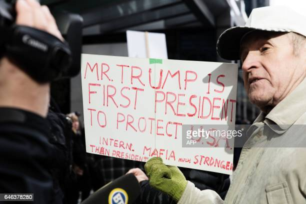Protesters demonstrate on the opening day for the Trump International Hotel and Tower in Vancouver on february 28 2017 / AFP / Stephanie Lamy