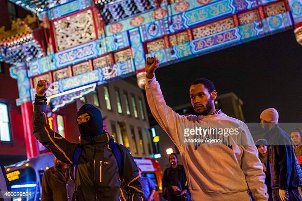 Protesters demonstrate on the streets of Washington during a protest after two grand juries decided not to indict the police officers involved in the...