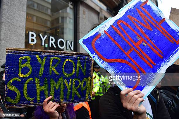 Protesters demonstrate outside a Byron burger restaurant on August 1 2016 in London England Protesters are opposing an alleged training exercise...