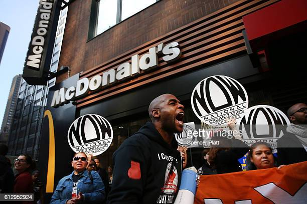 Protesters demonstrate outside of a McDonald's restaurant near Times Square after charges were brought against the company that they have ignored...