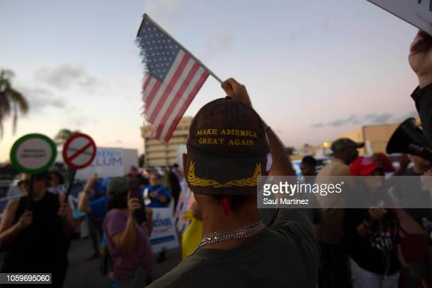 Protesters demonstrate outside the Broward County Supervisor of Elections office on November 9 2018 in Lauderhill Florida According to reports both...