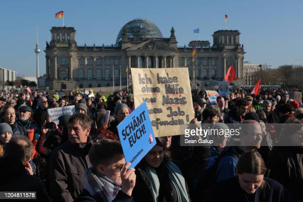 Protesters demonstrate outside the Chancellery where the government coalition commission was meeting as the Reichstag stands behind on February 08...