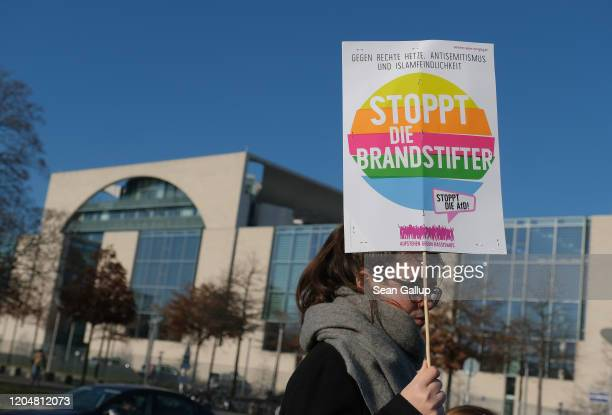 Protesters demonstrate outside the Chancellery where the government coalition commission was meeting on February 08 2020 in Berlin Germany The...