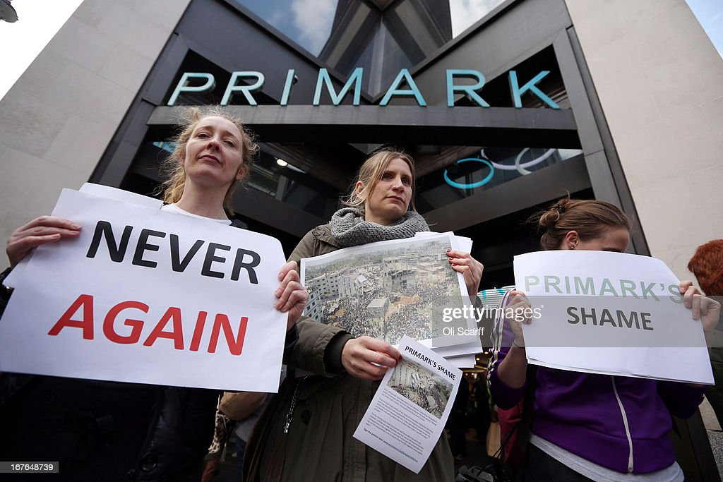 Protesters demonstrate outside the flagship Primark shop on Oxford Street on April 27, 2013 in London, England. The campaigners are calling for compensation for victims of the April 24, 2013 clothing factory collapse in Dhaka, Bangladesh.
