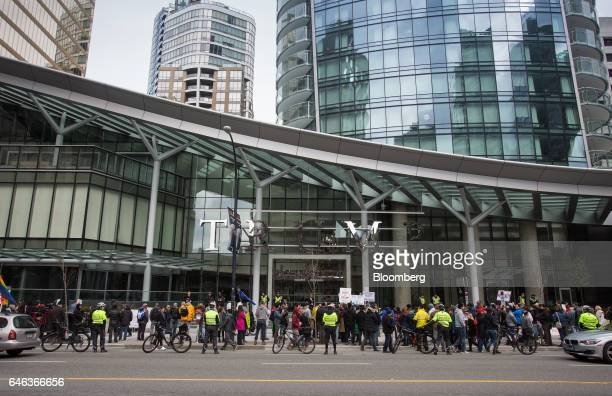 Protesters demonstrate outside the Trump International Hotel Tower during the opening ceremony in Vancouver British Columbia Canada on Tuesday Feb 28...