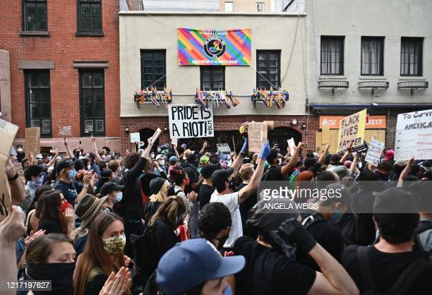 Protesters demonstrate past the Stonewall Inn on June 2 during a Black Lives Matter protest in New York City Antiracism protests have put several US...