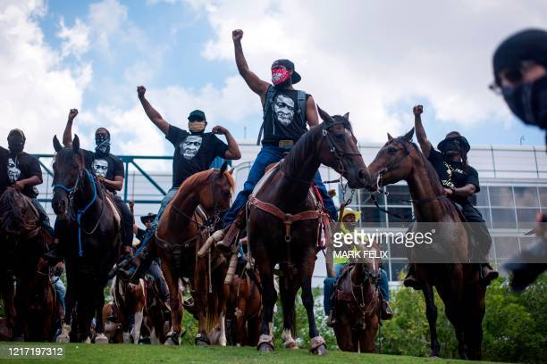 TOPSHOT Protesters demonstrate to mourn the death of George Floyd during a march across downtown Houston Texas on June 2 2020 Antiracism protests...