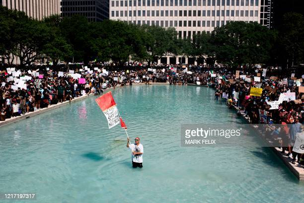 Protesters demonstrate to mourn the death of George Floyd during a march across downtown Houston Texas on June 2 2020 Antiracism protests have put...