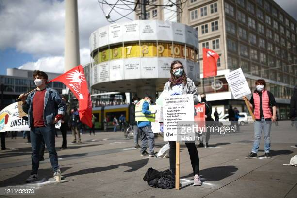 Protesters demonstrate while maintaining social distancing on May Day during the novel coronavirus crisis on May 1 2020 in Berlin Germany May Day...