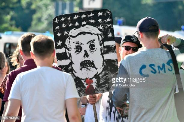 Protesters demonstrate with a cardboard featuring Us President Donald Trump during the 'Welcome to Hell' rally against the G20 summit in Hamburg...