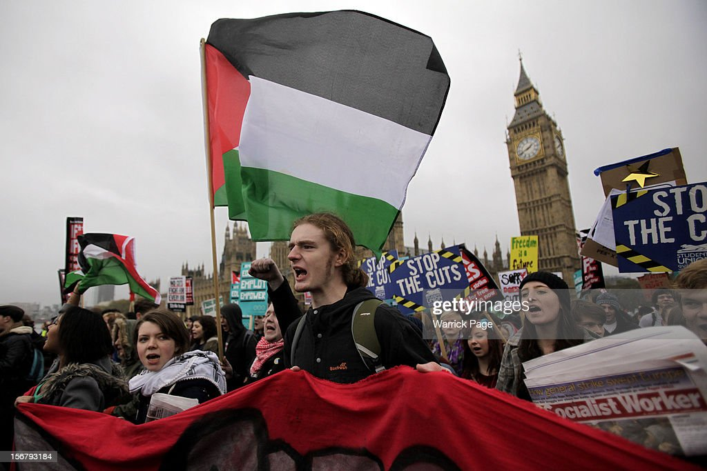 Protesters demonstrating against education cuts, tuition increases and austerity shout slogans outside the Houses of Parliament on November 21, 2012 in London, England. The demonstration march was organised by the National Union of Students (NUS) and is the first national student protest since a series of violent protests against tuition fees two years ago.