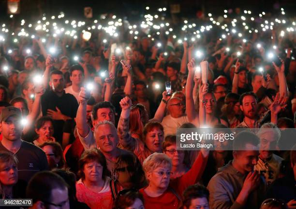 Protesters demonstrating against the rightwing government of Hungarian Prime Minister Viktor Orban hold a rally on April 14 2018 in Budapest Hungary...