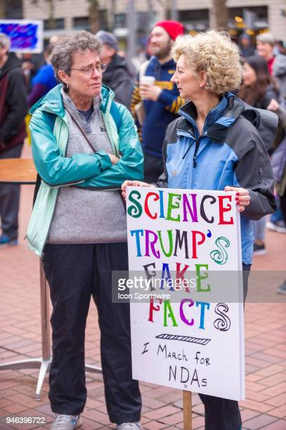 Protesters denoucnce an alleged antiscience agenda by US President Donald J Trump at the March for Science on April 14 in downtown Portland OR
