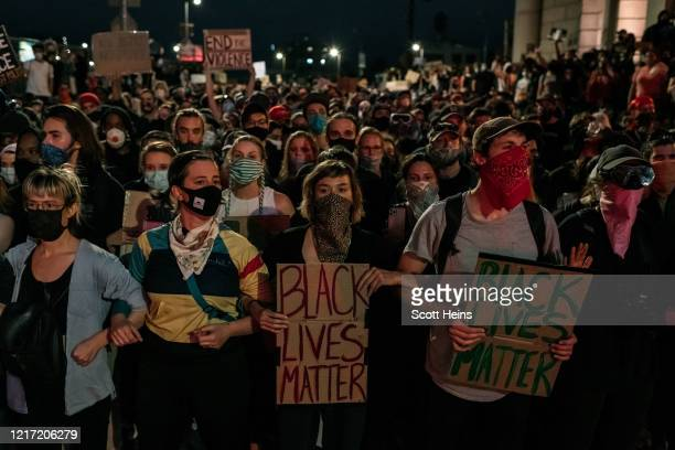 Protesters denouncing police brutality and systemic racism are kept in place on the Manhattan Bridge by police for hours during a citywide curfew in...