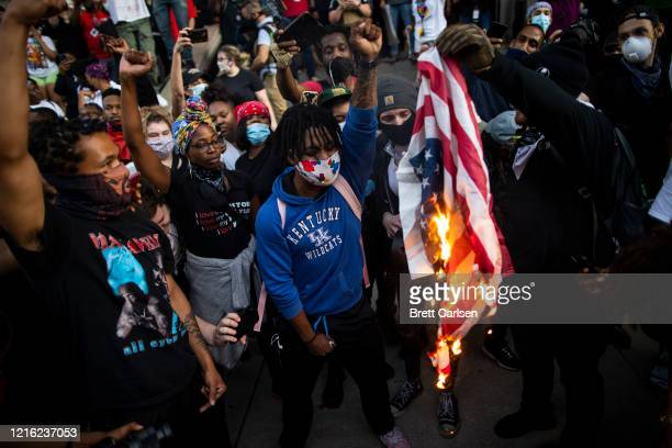 Protesters destroy government flags outside the hall of justice on May 29, 2020 in Louisville, Kentucky. Protests have erupted after recent...