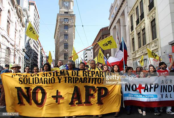 """Protesters display banners and shout slogans during a national demonstration against pension saving system organized by citizen movement """"'No AFP'""""..."""