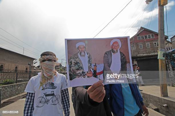 Protesters display pictures of Osama Bin Laden and Aiman AlZawahiri during a demonstration in Srinagar the summer capital of Indian controlled...