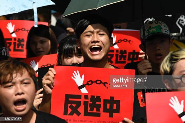 TOPSHOT Protesters display placards during a demonstration in Taipei on June 16 in support of the continuing protests taking place in Hong Kong...