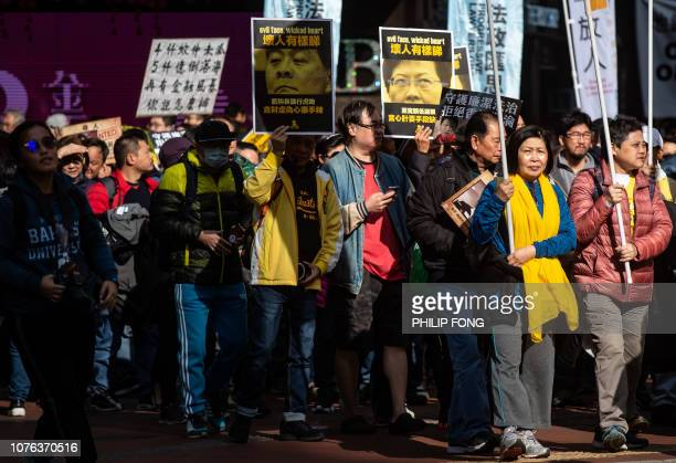 Protesters display placards of former chief executive Leung Chunying and current leader Carrie Lam during the annual New Year's Day prodemocracy...